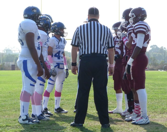 San Diego and Kearny team captains meet at midfield for the coin toss