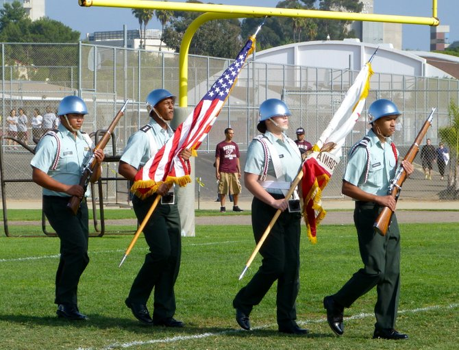 Members of Kearny High's Army Junior ROTC present the colors before the San Diego-Kearny game