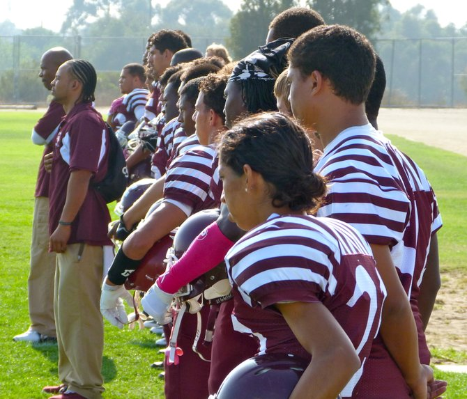 Kearny players salute the flag during the National Anthem
