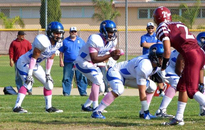 San Diego quarterback Deshaun Scott (right) and running back Canek Bustillos (left) in the backfield
