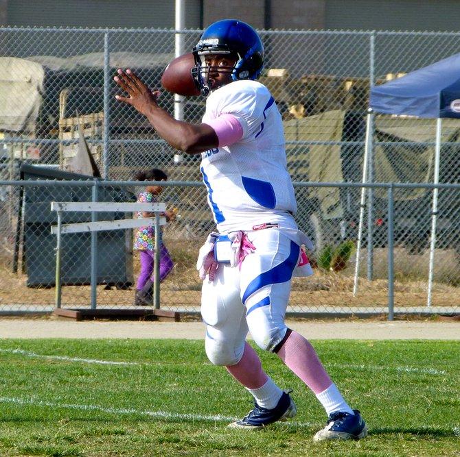 San Diego quarterback Deshaun Scott fires a pass