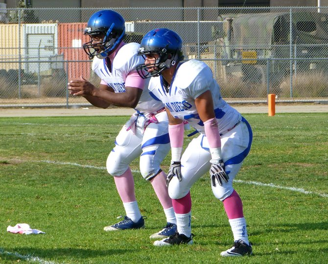 San Diego quarterback Deshaun Scott (left) and running back Canek Bustillos in the backfield