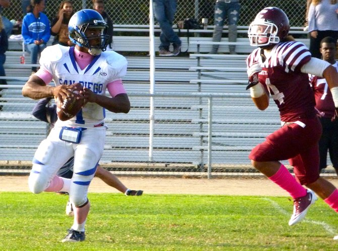 San Diego quarterback Deshaun Scott looks for a receiver with Kearny linebacker Calvin Rogers closing in on the pass rush