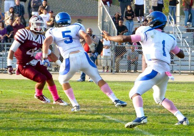San Diego quarterback Deshaun Scott fires a pass downfield