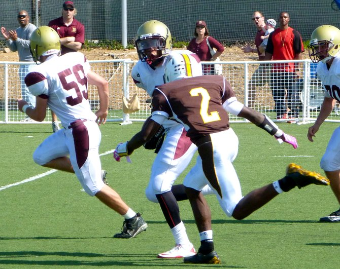 Bishop's receiver Dominique Love tries to outrace Francis Parker defensive back Ayman Mayberry in the secondary