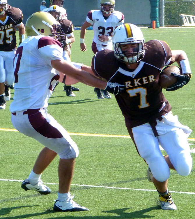 Francis Parker receiver Tony Gallanis fights through the tackle attempt of Bishop's linebacker Zack Wood