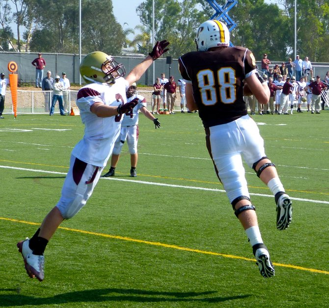 Francis Parker tight end Bryce Fitzner hauls in a touchdown pass in front of Bishop's defensive back Jake Dempsey