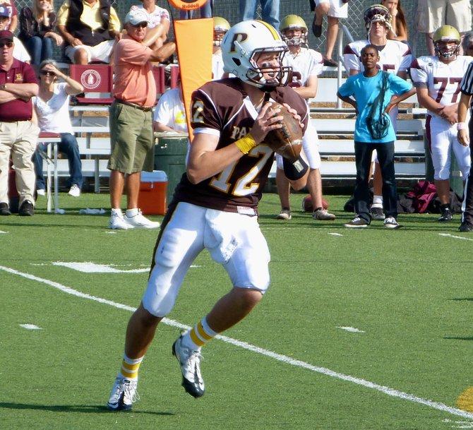 Francis Parker quarterback Gabe Harrington rolls right