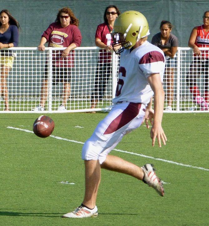 Bishop's punter Matt Harris kicks the ball downfield