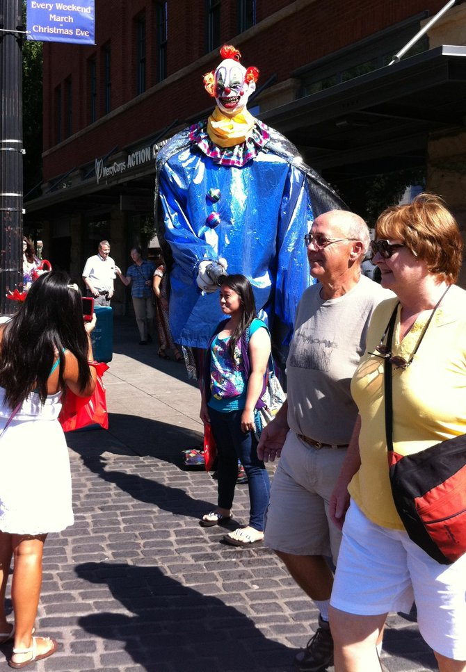 Yep, that's a giant clown with a gun to a girl's head at a public market in Portland, Oregon. Just good times.
