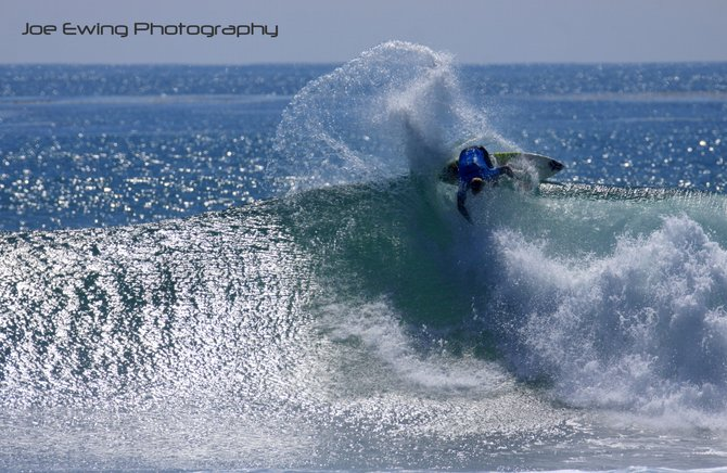Australian Pro Surfer Bede Durbidge carving a 360 degree turn on a perfect Trestles Reef wave.  San Onofre State Park, CA