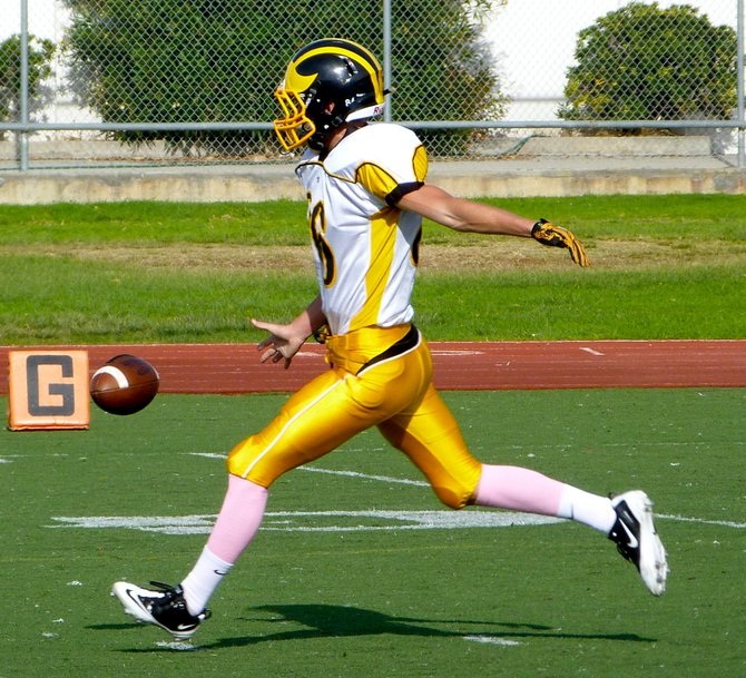 Mission Bay punter Kelly Weese boots the ball downfield