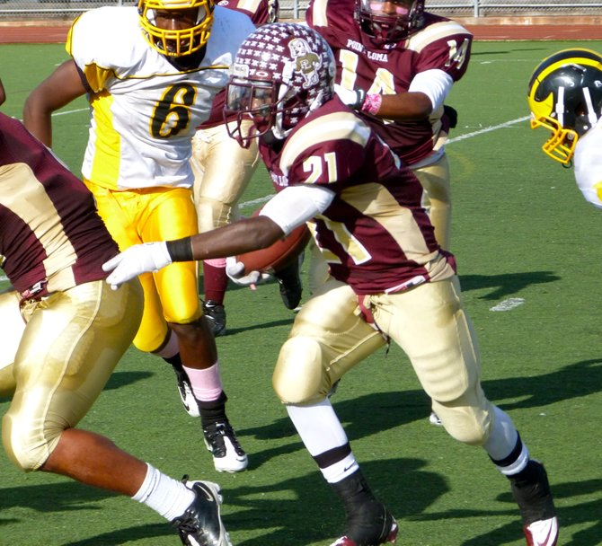 Point Loma running back Jaivon Griffin carries the ball in traffic