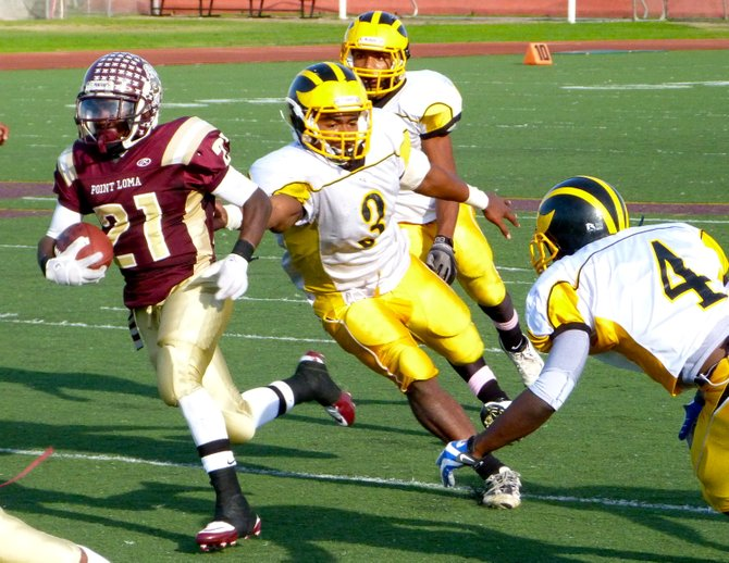 Point Loma running back Jaivon Griffin leaves three Mission Bay defenders in his wake