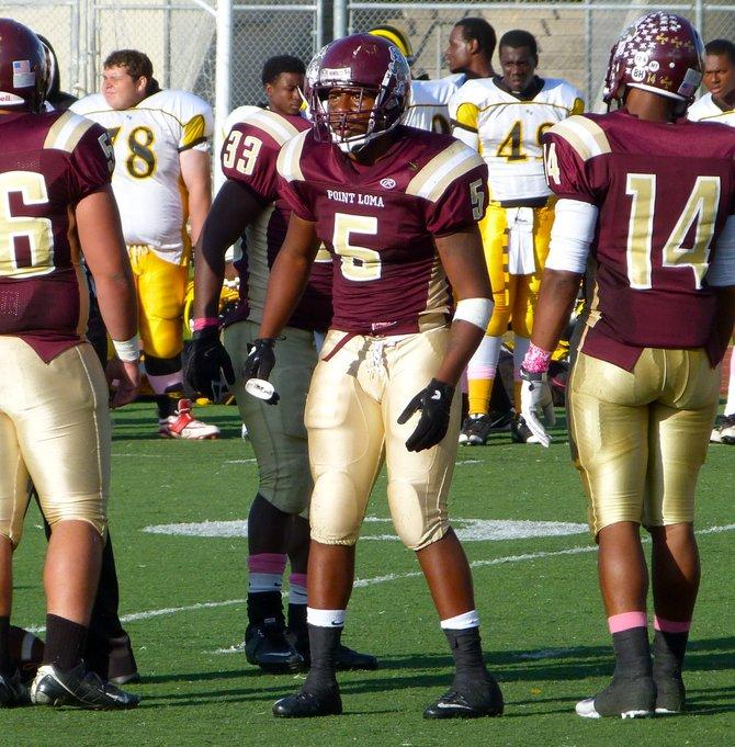 Point Loma linebacker Edmond Tucker looks to the Pointers sideline