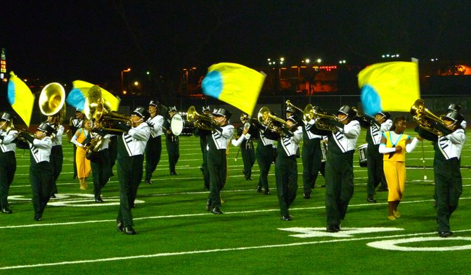 Oceanside's band and color guard perform during halftime of the Pirates' game against La Costa Canyon