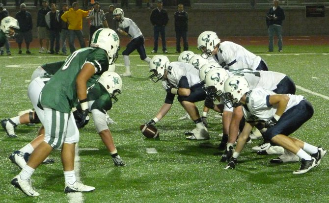 La Costa Canyon's offense lines up across from Oceanside's defense