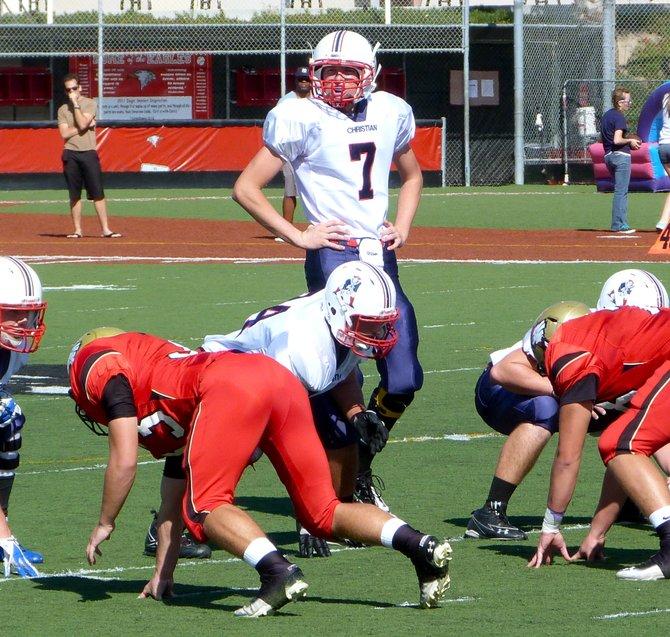 Christian quarterback Shane Dillon checks the Santa Fe Christian defense at the line of scrimmage