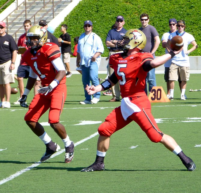 Santa Fe Christian quarterback Connor Moore fires a pass downfield with Eagles running back Jarrod Watson-Lewis blocking him