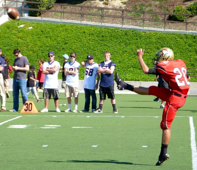 Santa Fe Christian punter Drew Shields boots the ball downfield