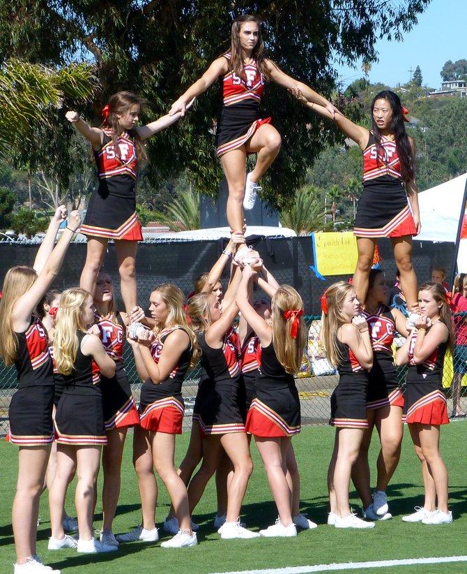 Santa Fe Christian cheerleaders celebrate an Eagles' touchdown against Christian