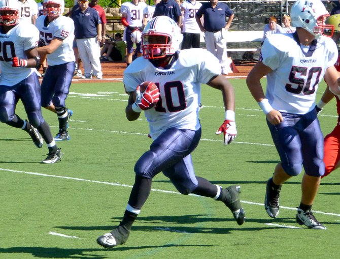 Christian quarterback Rayvon Owens carries the ball in the open field