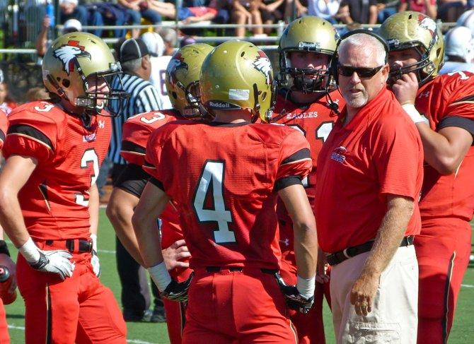 Santa Fe Christian huddles around coach Dan Egan during a timeout