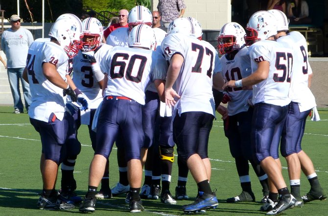 Christian in the offensive huddle