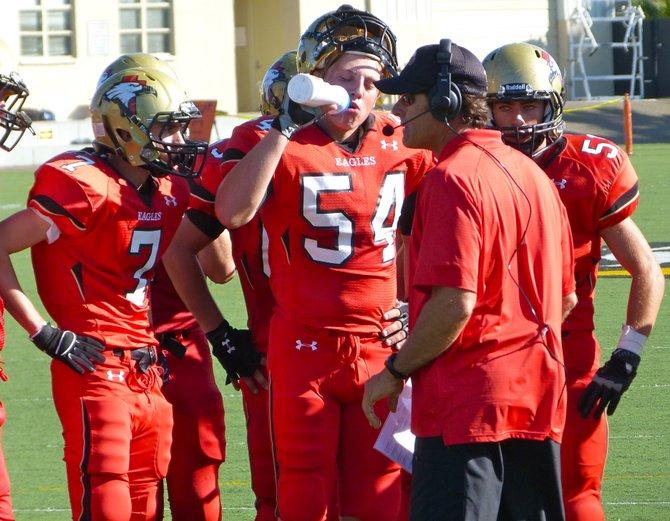 Santa Fe Christian huddles around head coach Nick Ruscetta during a timeout