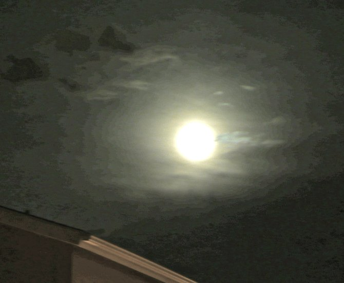 The huge moon seem to pulse as it bid adieu to 11-11-11 over North Park.