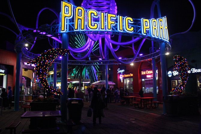 The Santa Monica Pier is alive at night time.
