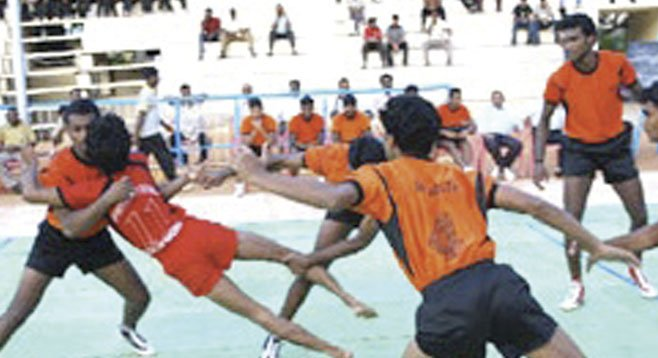 "In kabaddi, defensive players try to trap, circle, tackle, drape themselves over the ""marauding raider."""