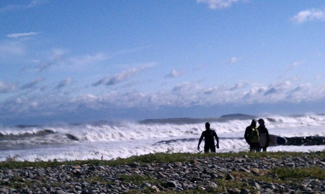 New England surfers check out conditions during unusual winter storm around Halloween 2011.