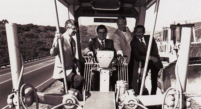 From Chula Vista Centennial, a photo of Mayor Greg Cox, seated in tractor, with developer Corky McMillin to his left.