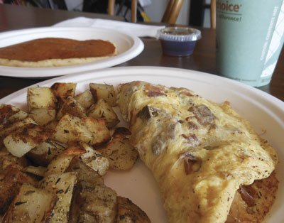My breakfast — an omelet with chunks of coffee-rubbed tri tip, bacon, three cheeses, potatoes, 