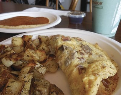 My breakfast — an omelet with chunks of coffee-rubbed tri tip, bacon, three cheeses, potatoes,  and a pancake ($7)