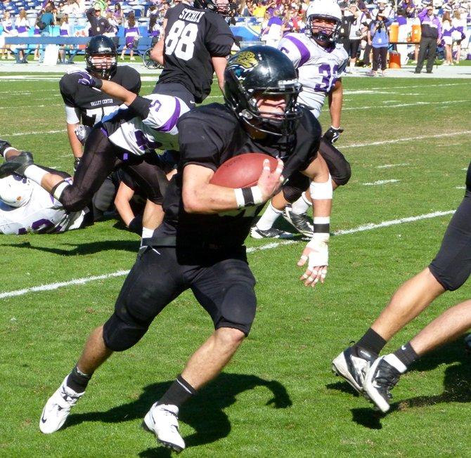 Valley Center running back Garrett Fiehler carries the ball outside for a touchdown run against Santana