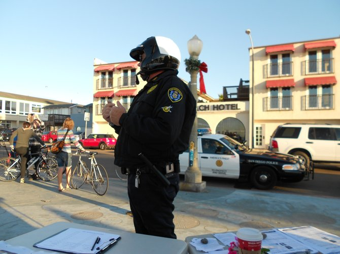 """The Man"" asking about the ASA March protest route so he can escort the group safely through Ocean Beach."