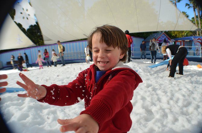 My son, pelting me with a snow ball, at Sea World's Snow World.