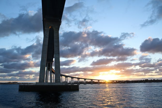 Photo of the Coronado bay Bridge, taken from the Hornblower Harbor Cruise as the sun sets.