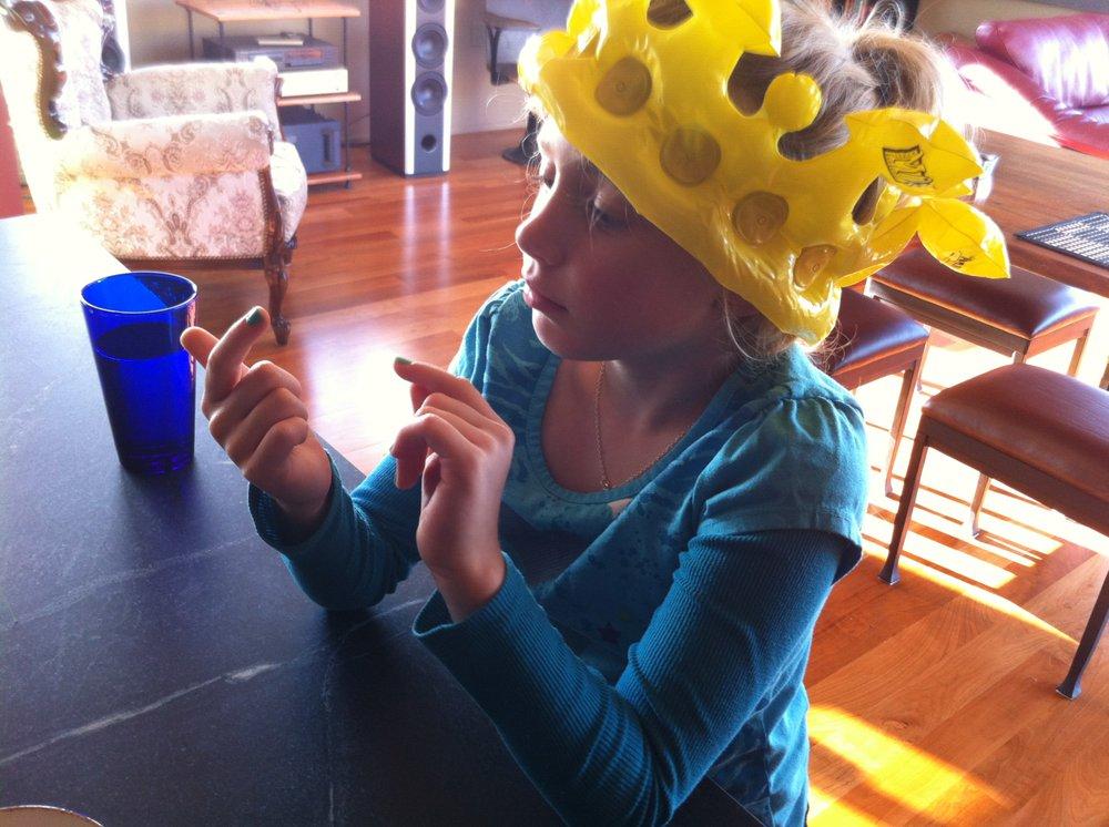 Bella examines vanilla bean specks