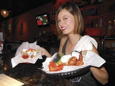 Jennifer serves my wings and taco at U-31.