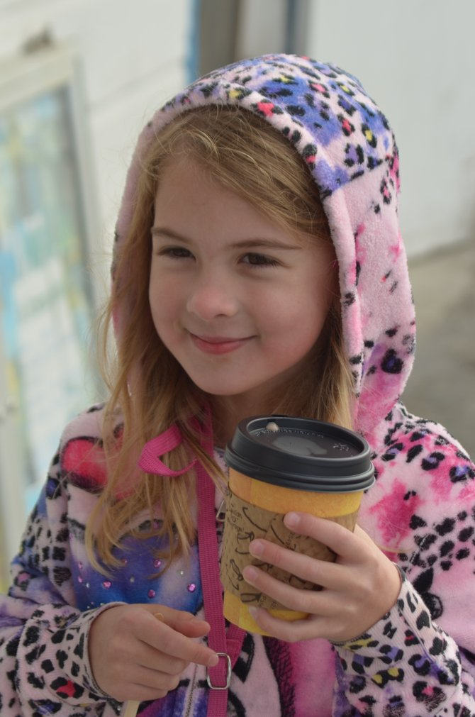 My daughter, drinking hot chocolate next to the Cafe on Ocean Beach Pier on a very cold and very foggy morning...
