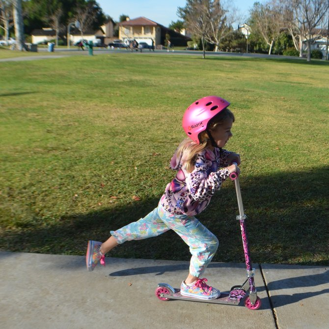 My daughter showing off her mad scooter skills at Princess Park, in Del Cerro