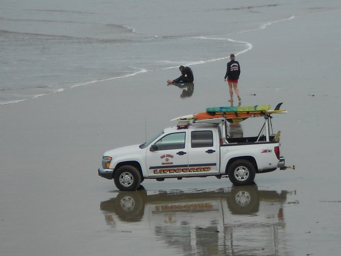 OB Lifeguard checking on surfer during big wave days.