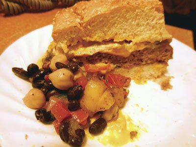 Half-pounder burger and bean salad.