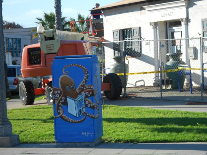 OB Library getting a facelift but nice utility box art out front with a reading octopus.