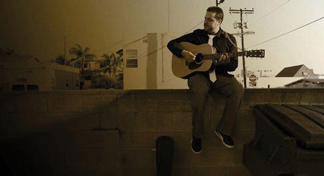 La Mesa troubadour Lenny Morris left hanging by Jolt 'N Joe's.