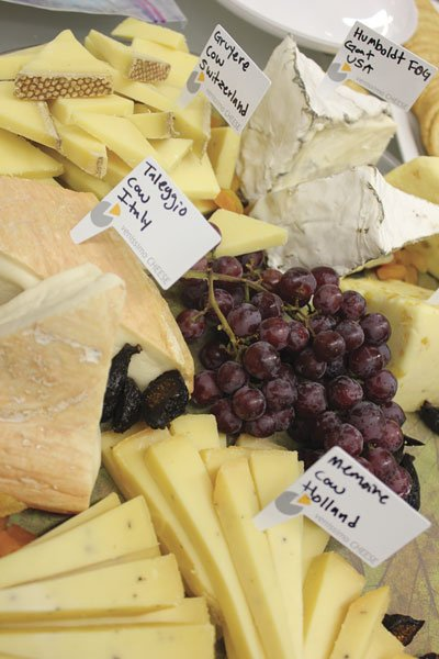 Members sample cheese from around the world, as well as homemade offerings.