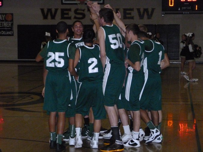 Poway huddles up before its game at Westview